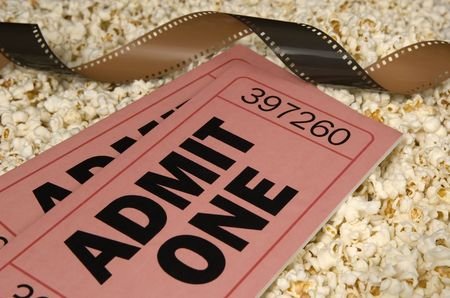 oversized movie tickets with film and popcorn background