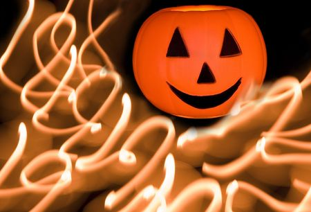 Pumpkin with streaking candle light. Stock Photo