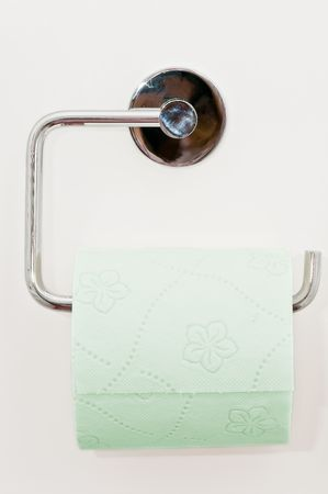 Toilet paper on the white wall Stock Photo - 4621188