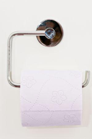 Toilet paper on the white wall Stock Photo - 4621179