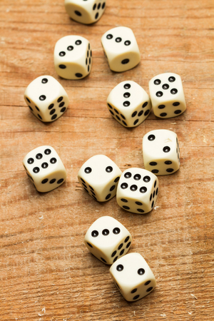 White dices on a wooden table