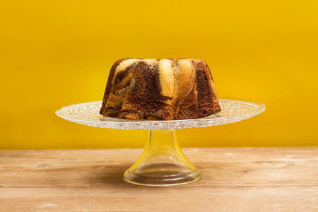 A chocolate and vanilla marble cake on a plate