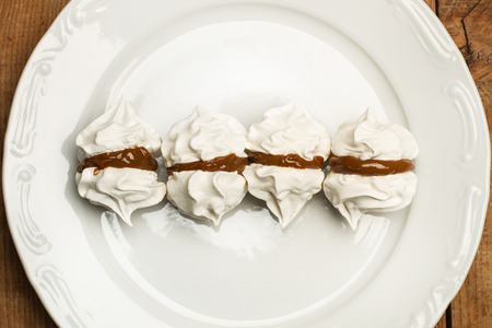 Meringues with caramel on a plate