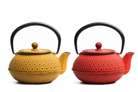 Red and yellow japanese teapots