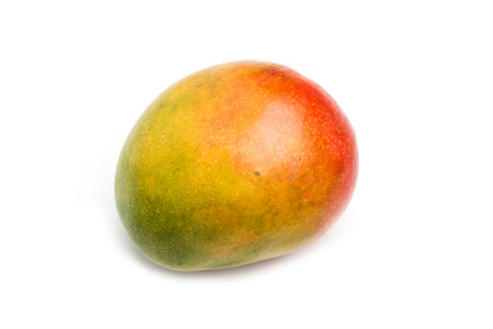 A mango fruit in a cut out view Imagens