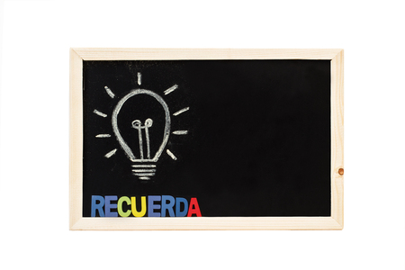 Blackboard with a light bulb and remember word in plastic letters 版權商用圖片