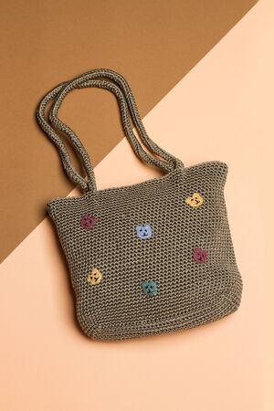 a brown womans bag on a brown background 版權商用圖片