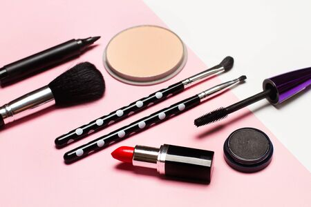 Blushes, brushes and a lipstick for make up on a pink background Banco de Imagens - 124997197