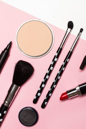 Blushes, brushes and a lipstick for make up on a pink background Banco de Imagens - 124997198