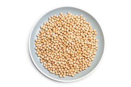 Raw chickpeas on a gray plate isolated on white