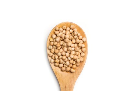 Cickpeas on a wooden spoon isolated on white