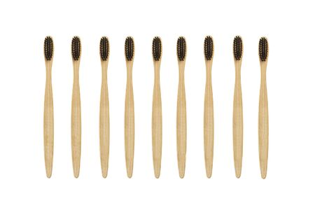 Bamboo toothbrushes with black bristles on an isolated view