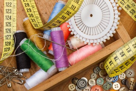 Sewing thread and sewing accessories in a wooden box