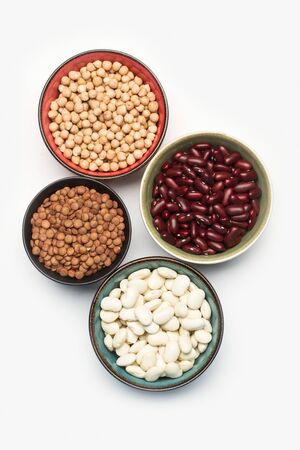 Beans, lentils and chickpeas in bowls