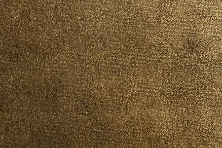 A golden wool cloth texture in a close up view
