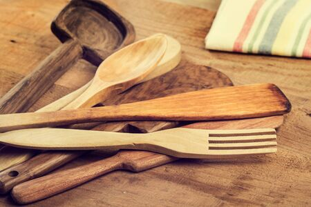 Wood kitchenware on a wooden table
