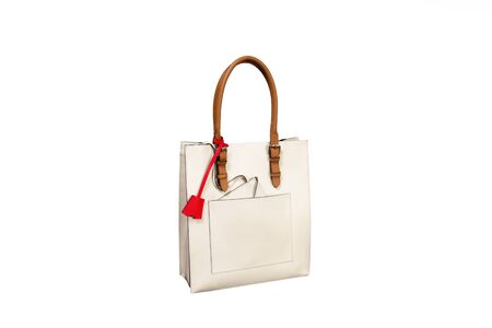 Woman leather hand bag on a white background