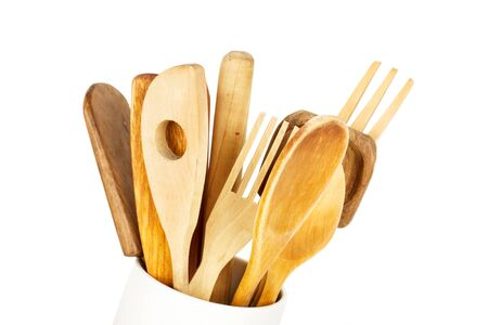 Wooden kitchenware on a white background