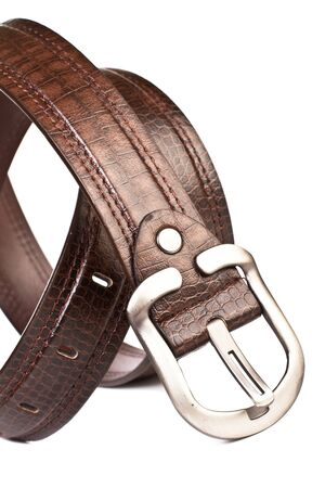 A brown leather belt on a white background
