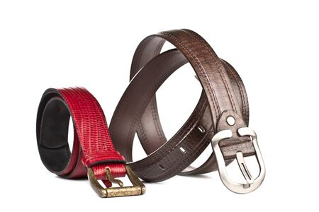 A red leather belt and a brown belt on a white background