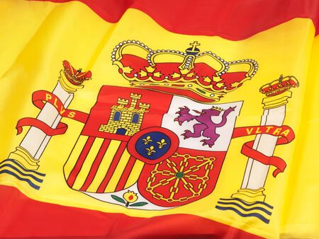 Spanish shield in spanish flag in a close up view