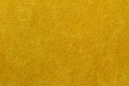 A yellow furry fabric texture Banque d'images - 129859127