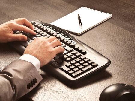 Man writing on computer keyboard