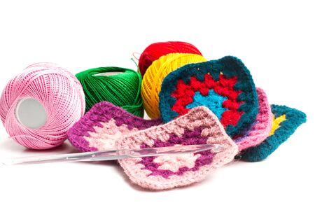Colored wool crochet doilies and thread balls