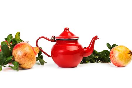 Pomegranates with a teapot on a white background.