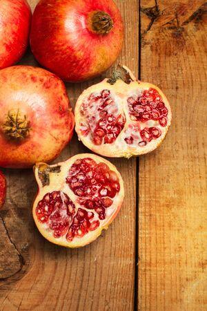 Pomegranates on a wooden table Stok Fotoğraf - 130599630