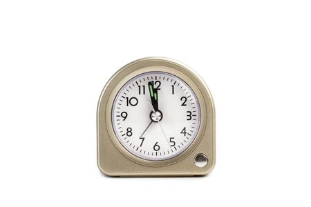 An alarm clock on a white background.