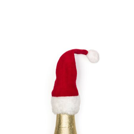 A bottle with santa claus cap on awhite background