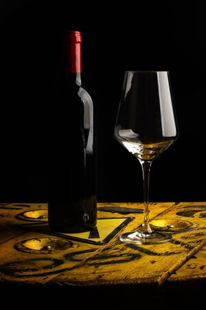 Serving a glass of red wine on a dark background