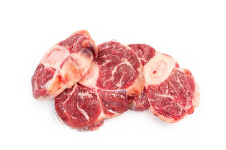 Raw osso buco on a white background