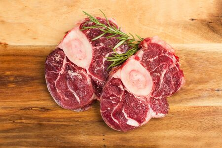 Raw osso buco on a wooden kitchen board Stok Fotoğraf