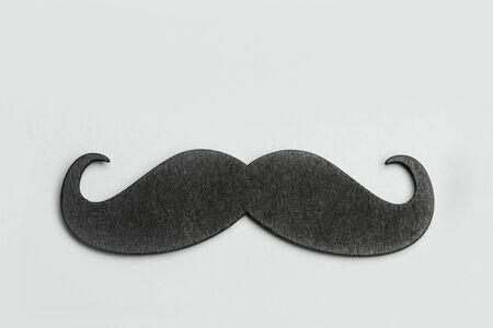 A black mustache on a gray background