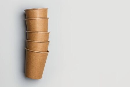 Disposable paper cups on a gray background in a top view