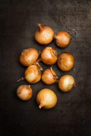 Small white french onions on a wooden table