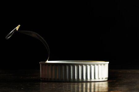 An open tin can in a dark background Stok Fotoğraf