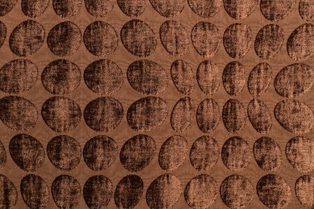 A texture of a brown wool textile with circles