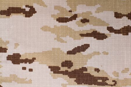 A texture of a pixelated camouflage fabric