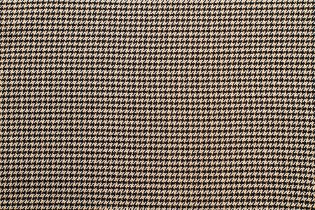 A texture of a checkered wool fabric
