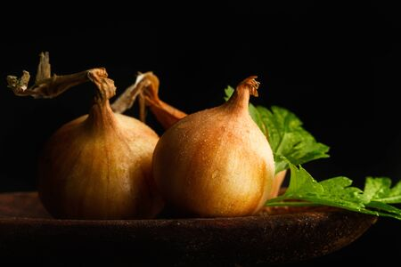Small white french onions on a dark background