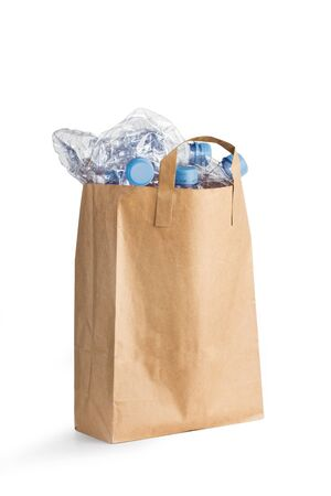 Empty plastic bottles in a brown paper bag