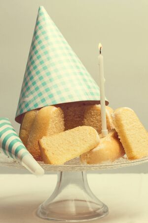Pieces of a birthday bundt cake with a burning candle