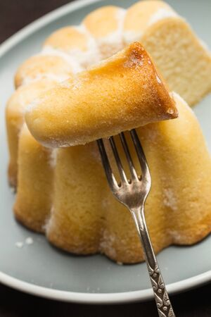 Pieces of a bundt cake on a gray plate
