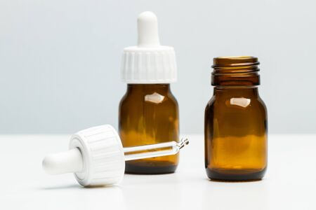 Medical bottles with a dropper on a white background