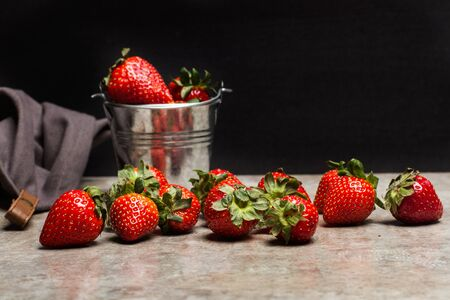 Delicious strawberries in a jar on a marble table and in a dark background Zdjęcie Seryjne