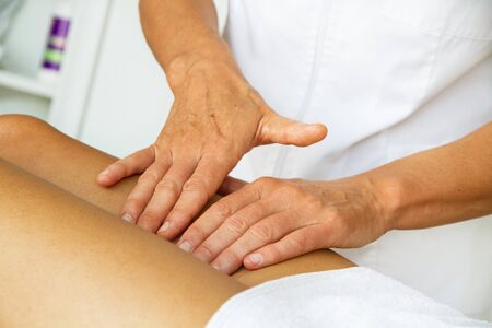 Massages and physiotheraphy to a woman on her legs