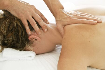 Professional massages to a woman on her neck and back Standard-Bild